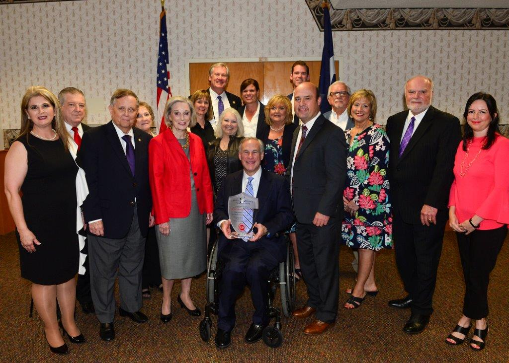 Pictured from left to right (front row): Cindy Carrillo; Dr. Baker Pattillo; Pattye Greer; Governor Greg Abbott; Republican Party Chairman, Dale Morton; Loretta Cammack; Senator Robert Nichols; Lori Cotton Back: John Ruckel; Mary Ann Derby; Donna Finley; Rep. Travis Clardy; Judy Clardy; June Clifton Price; Luke Clardy; County Judge Mike Perry.